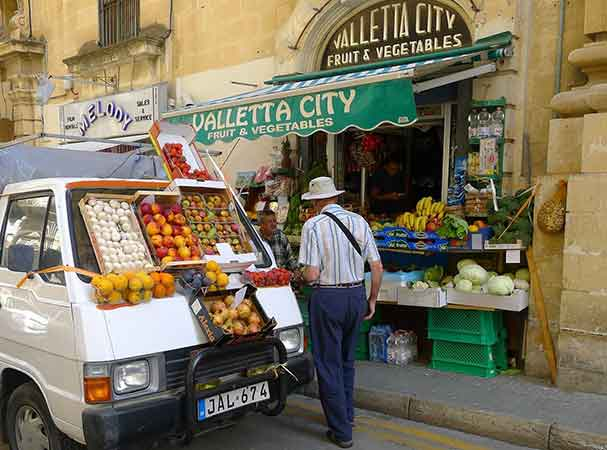 Living in Malta - At every corner, you will be able to find either minivans or corner shops selling local produce.